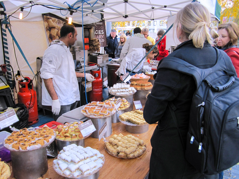 people at a food market, as seen during a walk along the Thames