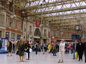 people in a large European train station, as seen during a walk along the Thames