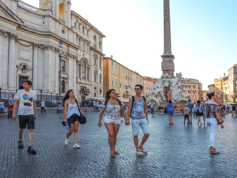 young people walking across the Piazza Navona