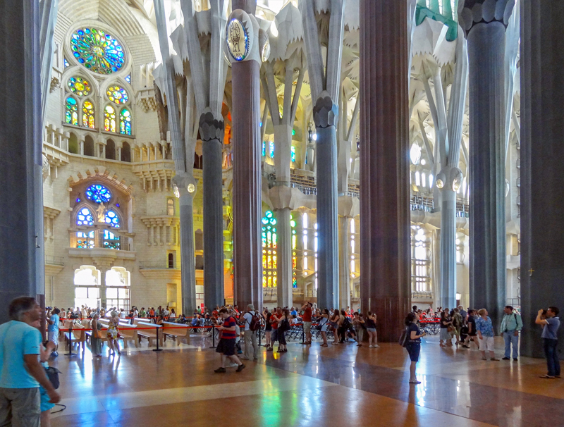 people in a colorful cathedral - one of the Gaudi buildings