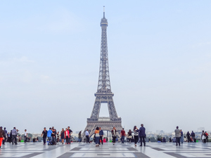 people by the Eiffel Tower in PAris