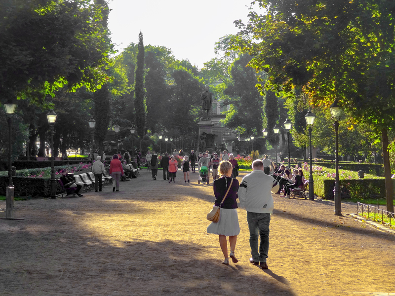 people walking along a broad path in a park, one of the things to do in Helsinki