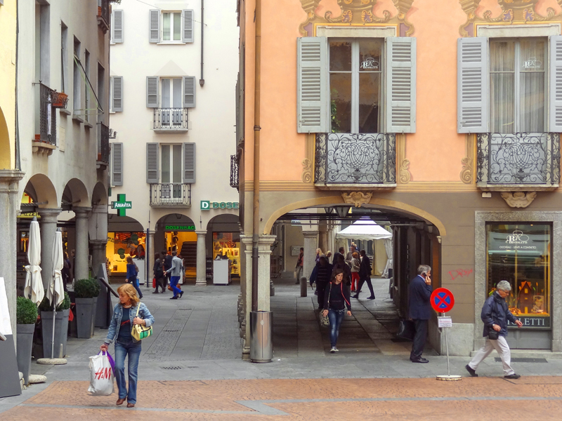 people looking at an arnate old building, one of the things to do in Lugano