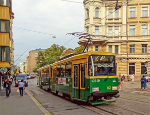 a trolley on a street with beautiful old buildings