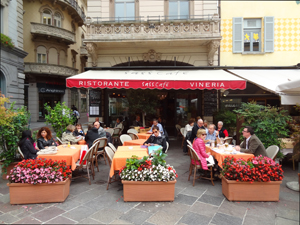 people in a cafe, one of the things to do in Lugano