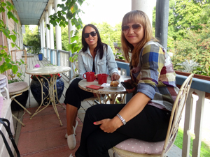 two women enjoying coffee in an outdoor cafe
