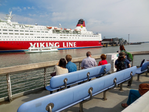 people looking at a cruise ship in Helsinki Harbor