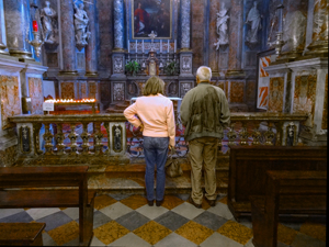 a couple standing in an ornate church
