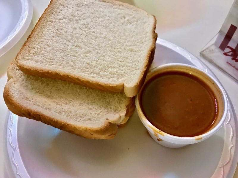 White bread and BBQ sauce served at every table | nevertooldtotravel.com | Gary House