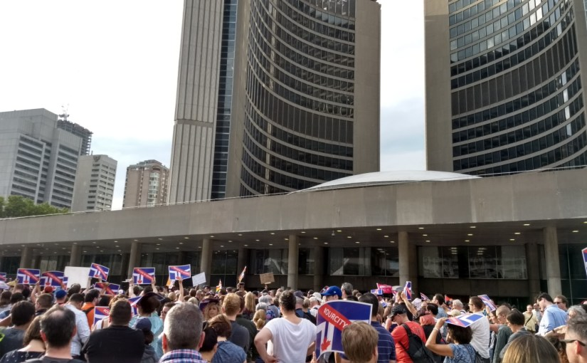 In front of Toronto City Hall, a crowd protests Doug Ford's decision to cut City Council in half.