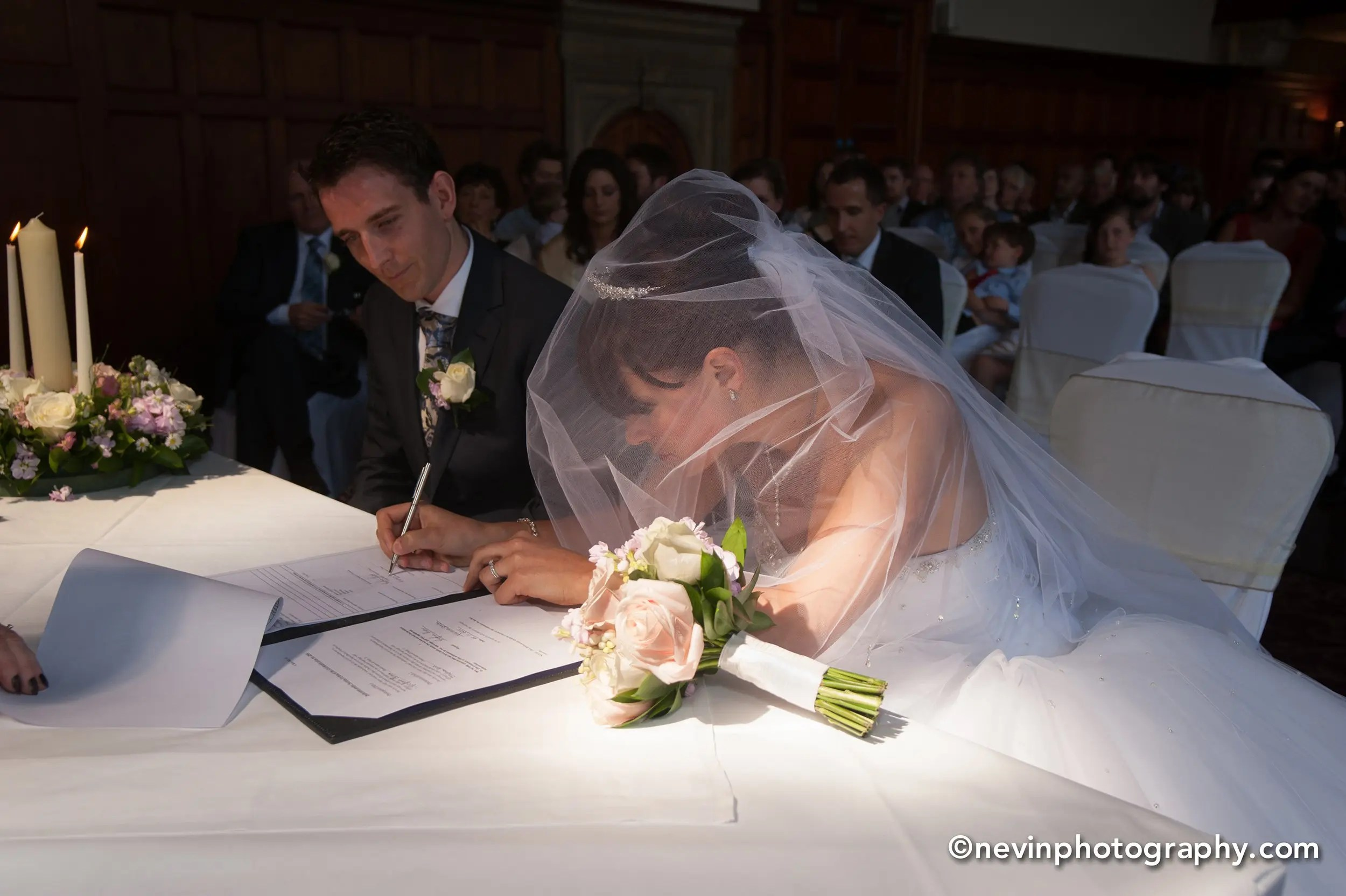 Signing the Register in Thomas Prior Hall Wedding