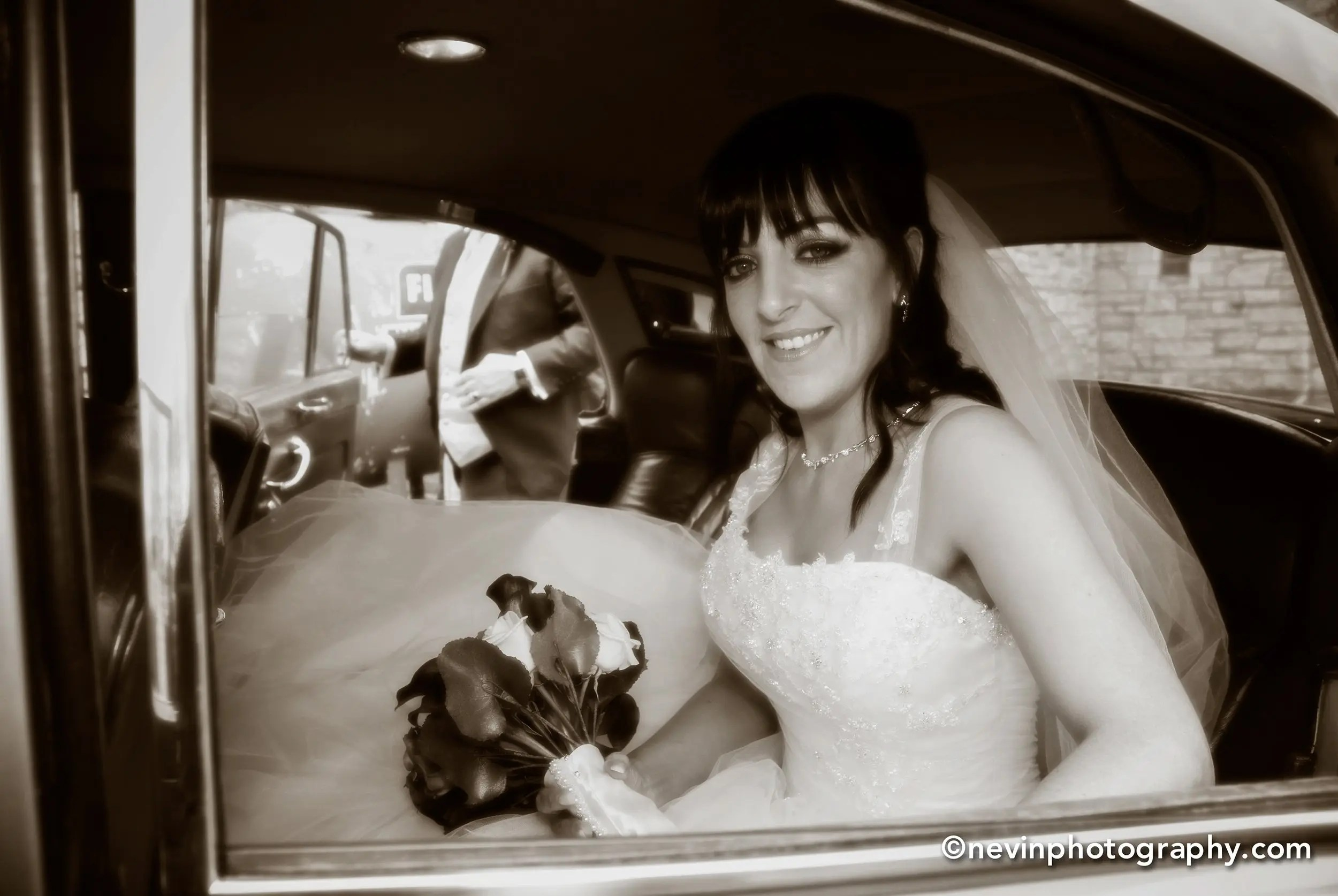 Black and white photo of Bride arriving at the church