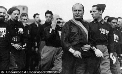 Il Duce (Mussolili) among Blackshirts.