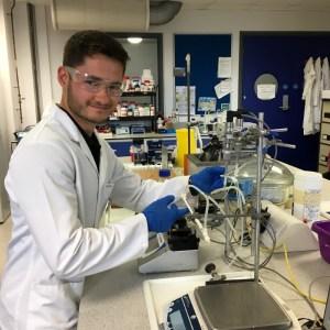 Scott Allan with a laboratory scale bioreactor at the University of Bath