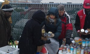 Congressman Bill Huizenga and his family help hand out food at The Beat's 2013 giveaway.