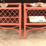 High gloss persimmon finished rattan end tables with glass shelves.