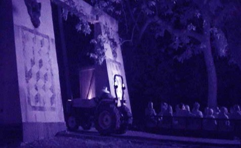 Los Angeles Haunted Hayride 2010: A tractor pulls victims through the gate leading to haunted territory.