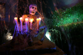 House at Haunted Hill skeleton with candles