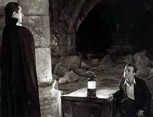 Renfield (Dwight Frye) cowers before his vampiric master.