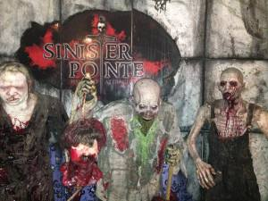 zombies in front of backdrop