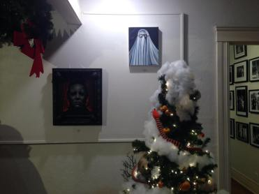 The Nightmare Before Christmas themed tree with Michael Myers art in background