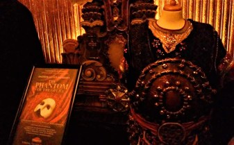 Costumes from the 2019 touring production of The Phantom of the Opera on display in the lobby of the Pantages Theatre Hollywood.