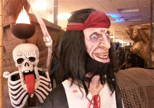 Skeleton photobombs pirate.