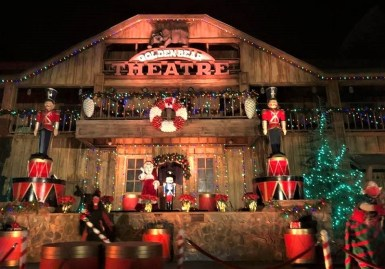 Nutcrackers, elves & Mrs. Claus outside the Golden Bear Theatre