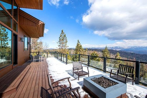 a peaceful view of a cabin's balcony in the expansive wilderness