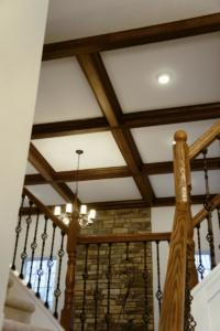 Great Room coffered ceiling and Iron Railing