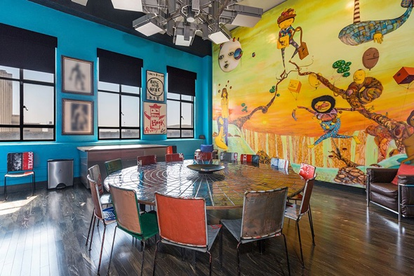 Johnny Depp's dining area with a mural by brazilian artists OSGEMEOS.