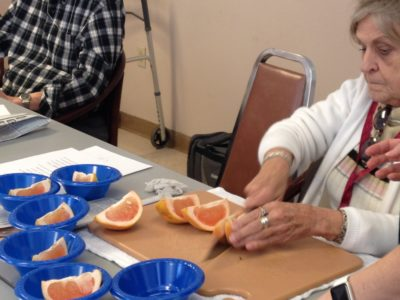 Edie cutting grapefruit