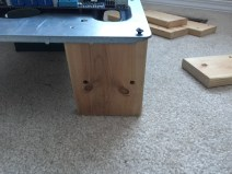 Screwing in the DIY PC Test Bench Legs