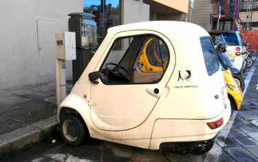 Little car getting juiced up (electric car) (Florence, Italy)