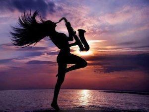 Saxophone playing woman
