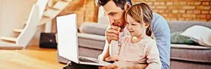 Father and Daughter log on to Newburyport Family Practice for an appointment