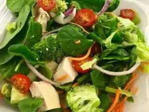Fresh Salad with tofu, broccoli, lettuce, and tomato