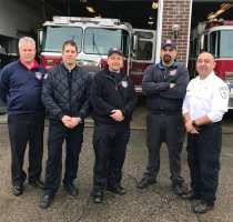 From left to right, Newburyport Fire Chief Christopher LeClaire , firefighters Joshua Mesina, Robert Morse and John Stomboly and paramedic Bob Piepiora standing outside Station 2 on Friday, Jan. 12.
