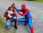 Spider-Man hanging out with Steven Jefferson and his daughter Kylah.