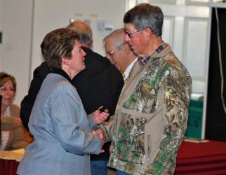 Rebecca Stackhouse giving a Vietnam 50th Anniversary Pin to Douglas Thurman, who served in the US Army from 1966 to 1967.