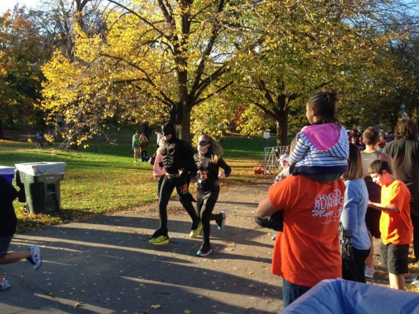 Runners nearing the finish line at the Pumpkins in the Park 5K/Photo: Zach Freeman
