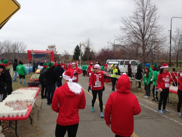 Runners cross the finish line at the Santa Hustle 5K/Photo: Zach Freeman