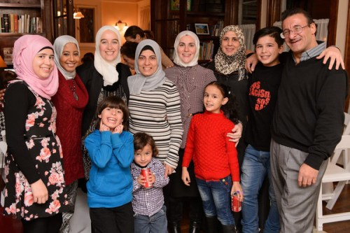 Suzanne Akhras Sahloul (center) at the Syrian Community Network #RefugeesWelcome Thanksgiving dinner in Evanston/ Photo: Syrian Community Network