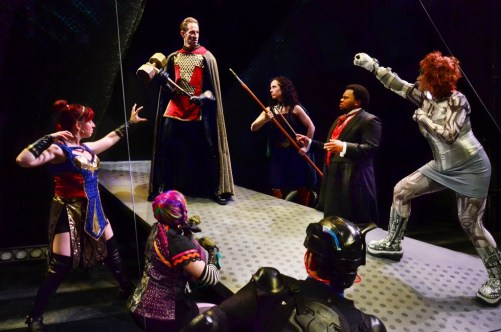 (Clockwise,      from L) Corrbette Pasko as Damsel,      Phil Timberlake as Dr. Impossible,      Sarah Scanlon as Elphin, Frederick Harris as Mr. Mystic, Christina Hall As Fatale, Tommy Malouf as Blackwolf, and Taryn Wood as Rainbow Triumph/Photo: Suzanne Plunkett