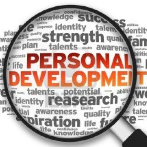 personal development words in a magnifying glass