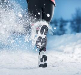 female legs running in snow