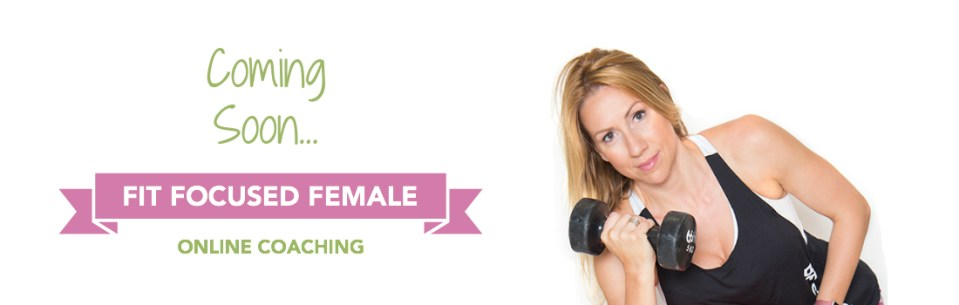 female personal trainer holding a dumbbell