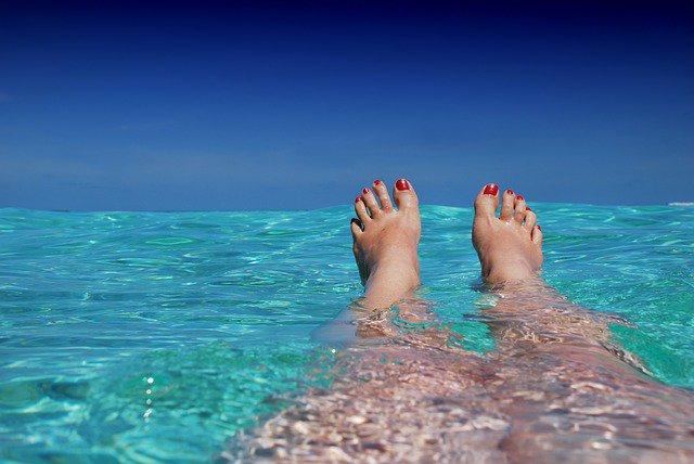 legs in the sea