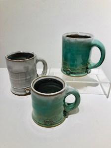 white and graduated green mugs