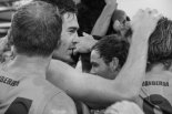 GWS players embrace after a big win over the Gold Coast Suns